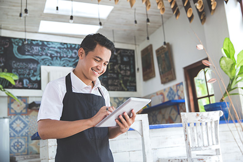 coffee_shop_owner_smiling_at_phone